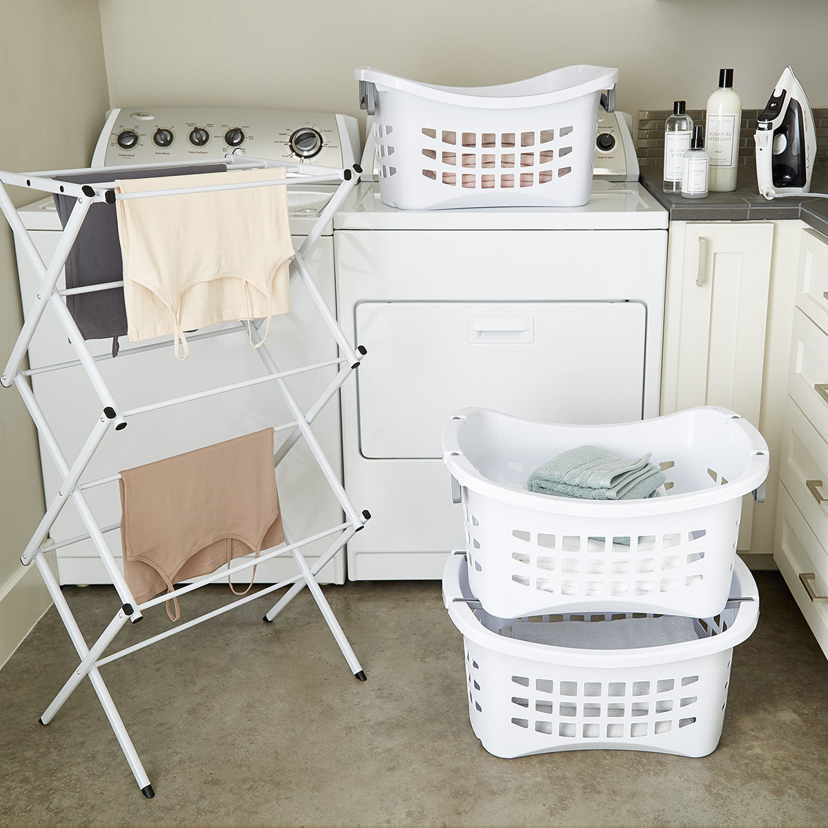 white stackable laundry basket with grey handles
